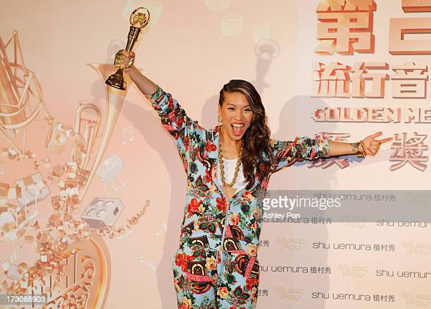 Taiwanese American singer Miss Ko holds her award for Best New Artist at the 24th Golden Melody Awards on July 6 2013 in Taipei Taiwan
