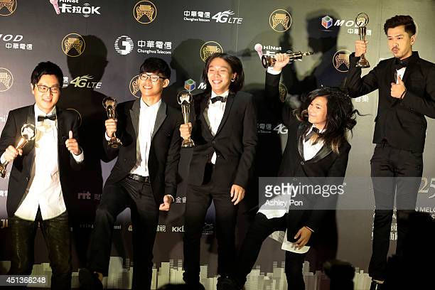 Taiwanese band Mixer pose for a photograph after receiving the award for Best Band at the 25th Golden Melody Awards event on June 28 2014 in Taipei...
