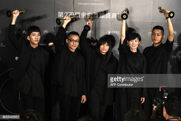 Taiwanese band No Party For Cao Dong display trophies after winning Best Band during the 28th Golden Melody Awards in Taipei on June 24 2017 Some of...