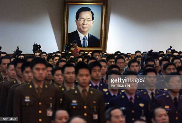 Taiwanese cadets stand against the backdrop of a picture of President Chen Shuibian during the joint graduation ceremony for the defense university...