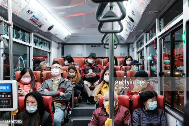 Taiwanese Citizens in Taipei City Bus wearing a chirurgical protection mask in order to protect themself from Corona Virus on 4 February 2020 in...