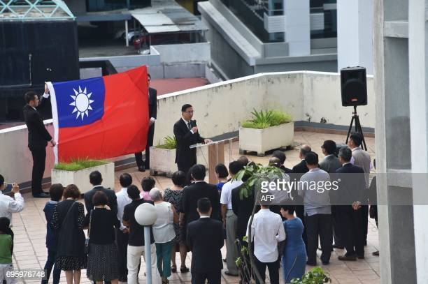 Taiwanese diplomatic personnel attend a flag recall ceremony atop the Taiwanese embassy to Panama building on June 14 2017 in Panama City Panama and...