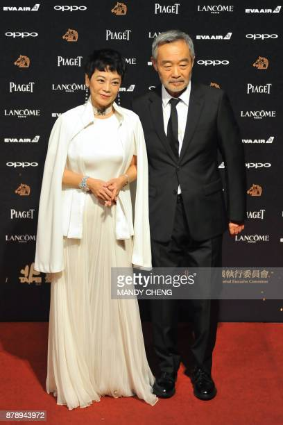 Taiwanese director and actress Sylvia Chang and Chinese actor Tian Zhuangzhuang arrive on the red carpet to attend Taiwan's 54th Golden Horse film...