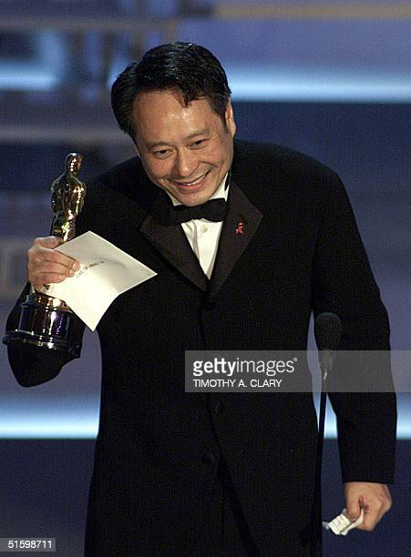Taiwanese director Ang Lee holds his Oscar for Best Foreign Language Film for Crouching Tiger Hidden Dragon at the 73rd Annual Academy Awards at the...