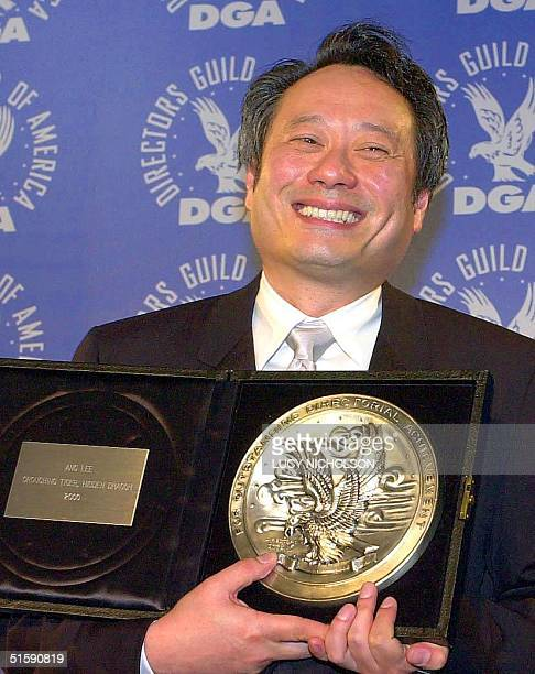 Taiwanese director Ang Lee poses with his nomination medallion for outstanding directorial achievement in a feature film for Crouching Tiger Hidden...