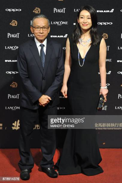 Taiwanese director Wen Ching Wu and Chinese actress Qin Hailu arrive on the red carpet to attend Taiwan's 54th Golden Horse film awards dubbed the...