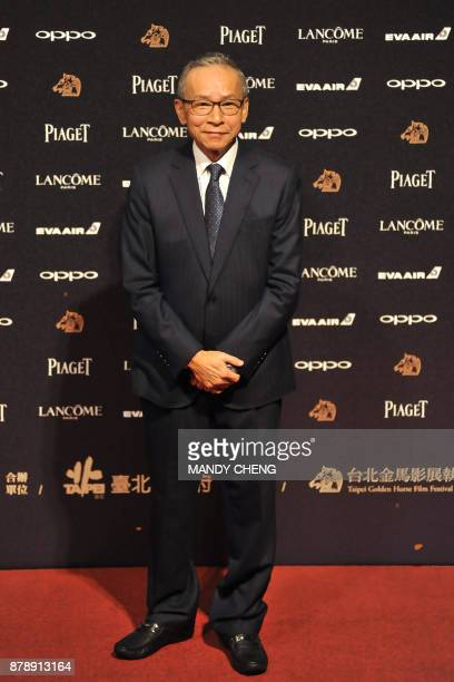 Taiwanese director Wen Ching Wu arrives on the red carpet to attend Taiwan's 54th Golden Horse film awards dubbed the Chinese 'Oscars' in Taipei on...