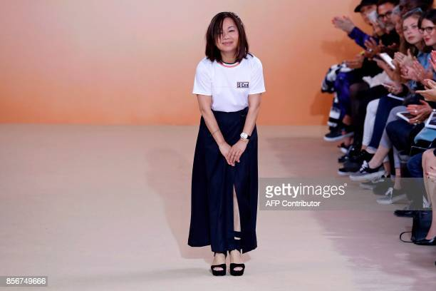 Taiwanese fashion designer Shiatzy Chen acknowledges the audience at the end of her women's 2018 Spring/Summer readytowear collection fashion show in...