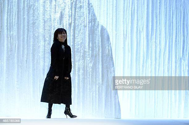 Taiwanese fashion designer Shiatzy Chen acknowledges the public at the end of her 20152016 fall/winter readytowear collection fashion show on March...