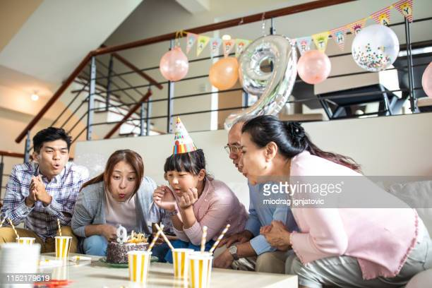 taiwanese girl celebrating birth with family at home - family at home stock photos and pictures