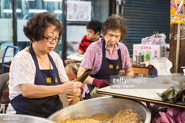 Taiwanese ladies wrap zongzi the traditional rice dumpling eaten during the Duanwu festival
