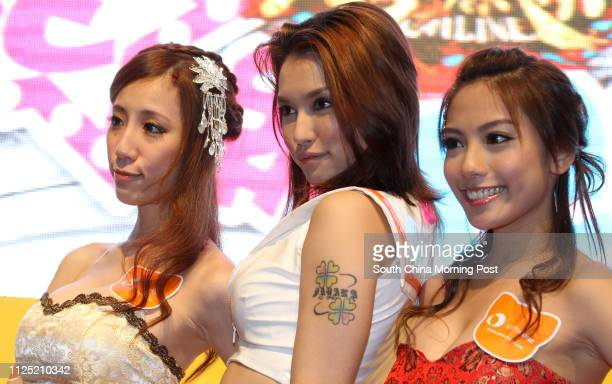 Taiwanese model Huang Yuiyui Japanese porn star Maria Ozawa and Hong Kong model Elaine Tang available for participants to have a hug during an event...