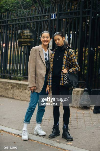 Taiwanese model Wang Yu and and Chinese model Tang He after the Miu Miu show during Paris Fashion Week Spring/Summer 2019 on October 2 2018 in Paris...