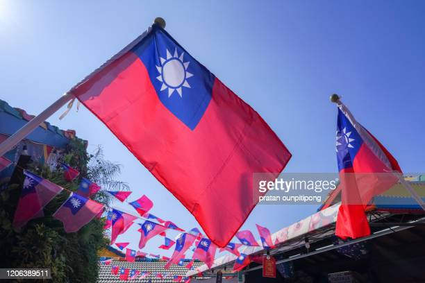 taiwanese national flags against clear blue sky - taiwan stock pictures, royalty-free photos & images