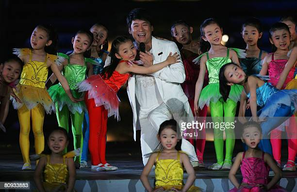 Taiwanese pop singer Emil Chau and girls sing the song ' We Are Ready' which was written especially for the the Beijing Summer Olympics during the...