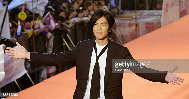 Taiwanese pop singer Jam Hsiao gestures from the red carpet of the 20th Golden Melody Awards in Taipei on June 27 2009 Performers from Taiwan Hong...