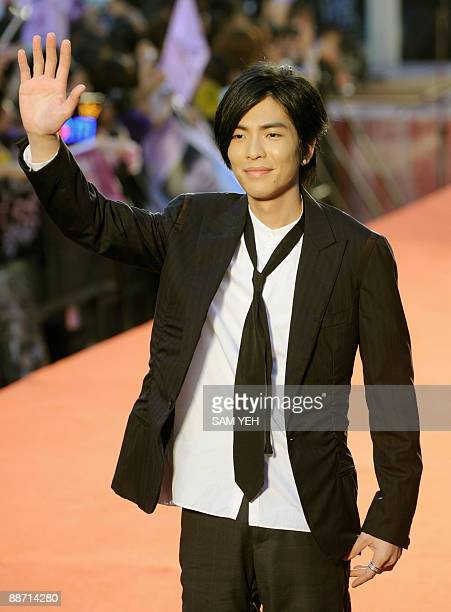 Taiwanese pop singer Jam Hsiao waves from the red carpet of the 20th Golden Melody Awards in Taipei on June 27 2009 Performers from Taiwan Hong Kong...