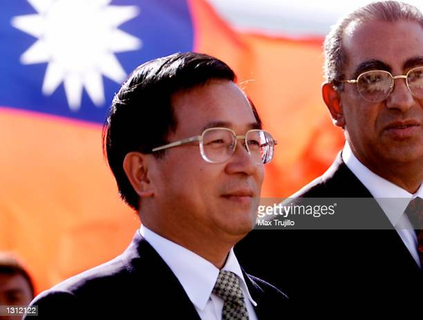 Taiwanese President Chen Shuibian left and President Carlos Flores of Honduras listen as the Honduran national anthem is played just after Chen''s...