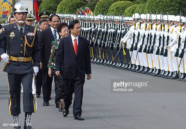 Taiwanese President Chen Shuibian reviews honor guard during the joint graduation ceremony for the defense university the army the air force the navy...