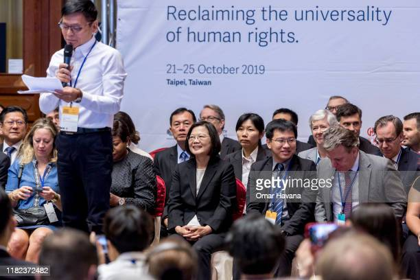 Taiwanese President Tsai Ingwen smiles while former death row inmate Hsu Tzuchiang gives a speech during the opening ceremony of the congress of the...