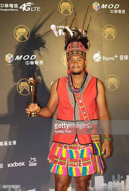 Taiwanese singer Chang Chenyue holds his award for Best Mandarin Album at the 25th Golden Melody Awards on June 28 2014 in Taipei Taiwan