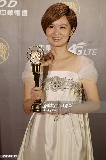 Taiwanese singer Huang Yeeling holds her award for Best Taiwanese Female Singer at this year's Golden Melody Awards on June 28 2014 in Taipei Taiwan