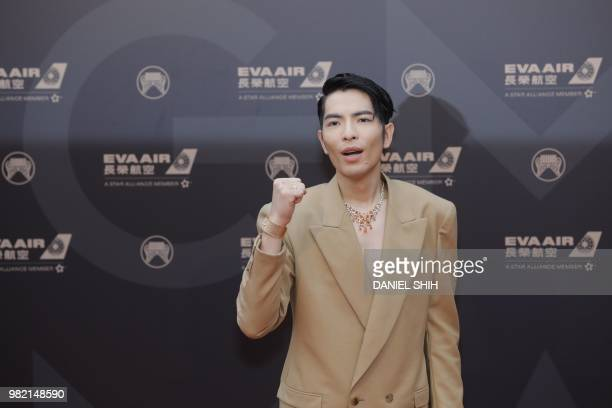 Taiwanese singer Jam Hsiao also the host of GMA poses for a photo on the catwalk during the 29th Golden Melody Awards Ceremony at the Taipei Arena on...