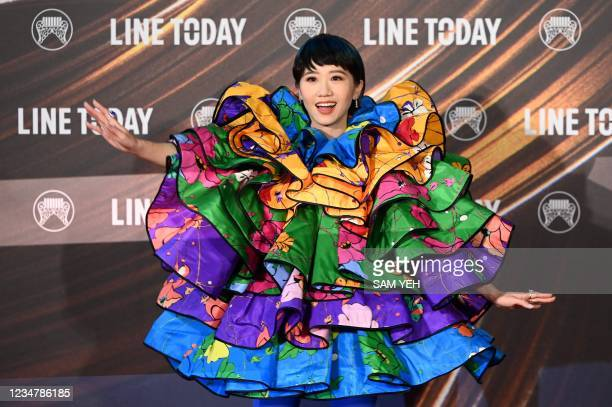 Taiwanese singer Lulu poses for photographs upon her arrival for the 32nd Golden Melody Awards in Taipei on August 21, 2021.