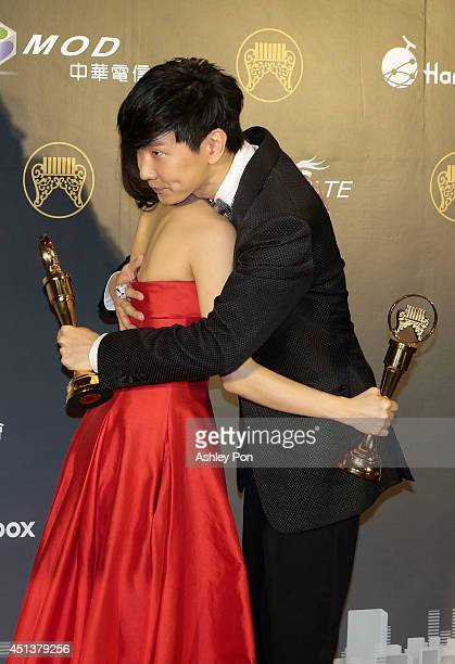 Taiwanese singer Penny Tai and Singapore singer JJ Lin hun each other after receiving their awards of Best Mandarin Female Singer and Best Mandarin...
