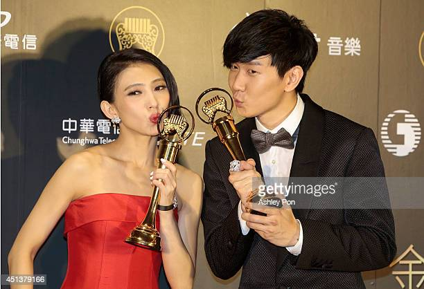 Taiwanese singer Penny Tai and Singapore singer JJ Lin pose for a photograph after receiving their awards of Best Mandarin Female Singer and Best...