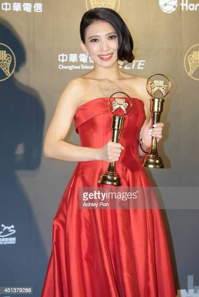 Taiwanese singer Penny Tai holds her awards for Best Female Mandarin Singer and Best Album Producer at this year's Golden Melody Awards on June 28...