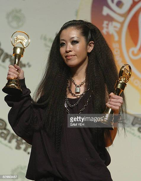 Taiwanese singer Sandee Chan holds her two trophies after winning the best album and best pop producer awards during the 16th Golden Melody Award in...