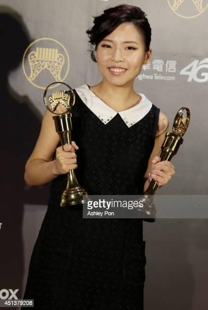 Taiwanese singer Tzeng Yachun holds her award for Best Hakka Singer and Best Hakka Album at this year's Golden Melody Awards on June 28 2014 in...