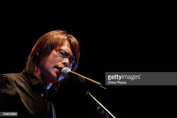 Taiwanese singer Wu Pai performs at the first 'Green Flag Erdos Grassland Rock Music Festival' near the Mausoleum of Genghis Khan on July 20 2007 in...