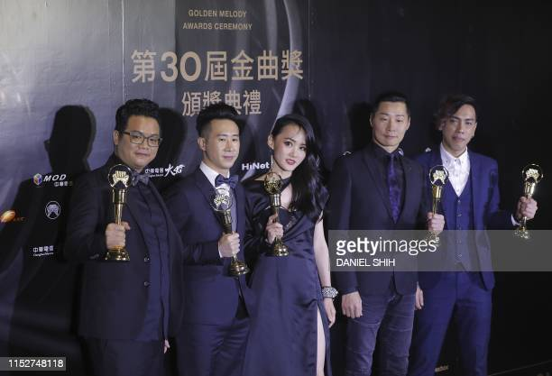 Taiwanese singers 'Chthonic' pose with their trophies after winning the Best Band at the 30th Golden Melody Awards in the Taipei on June 29 2019