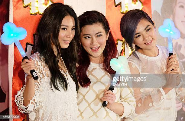 Taiwanese singers Hebe Selina and Ella pose for photos during a press conference to promote their concert in Taipei on April 24 2014 Taiwan's female...