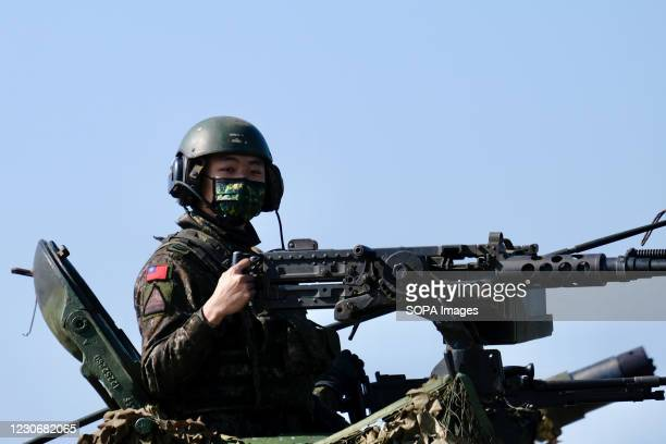 Taiwanese soldier on a tank at the Hukou military base during the military exercise ahead of next months Lunar New Year. Taiwan staged a military...