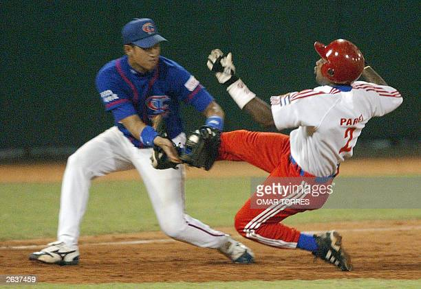 Taiwanese third base Wei Chen Chia puts out Cuban shortstop Roberto Paret at the top of the seventh inning during their XXXV Baseball World Cup...