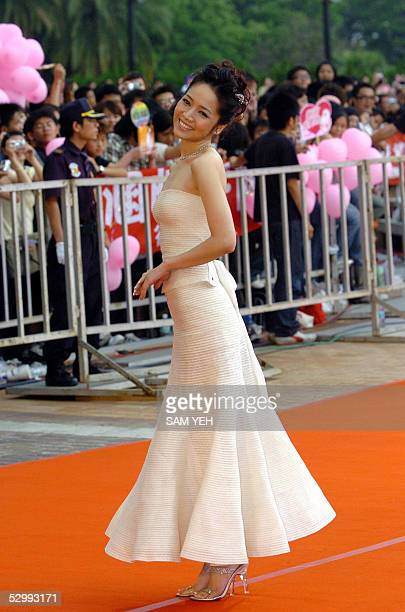 Taiwanese TV personality Patty Ho poses as she arrives at the 16th Golden Melody Award in Kaohsiung southern Taiwan 28 May 2005 Over 80 soloists or...