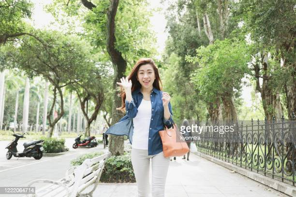 taiwanese woman greeting - kyonntra stock pictures, royalty-free photos & images
