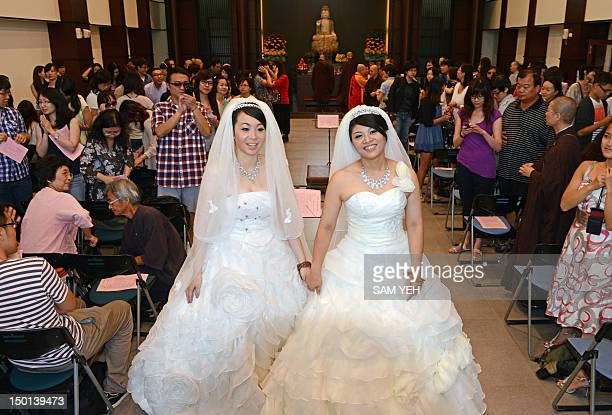 Taiwanese women Fish Huang and her partner You Yating pose for a photo during their samesex Buddhist wedding ceremony in Taoyuan on August 11 2012...