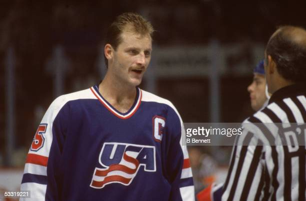 Taiwaneseborn professional hockey player Rod Langway of Team USA converses with a referee at the 1984 Canada Cup Canada 1984