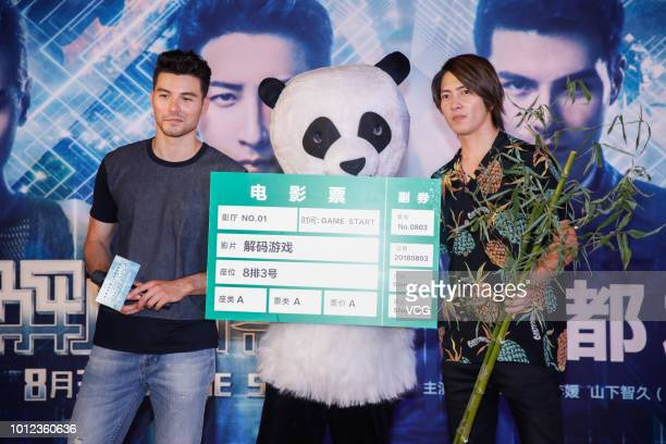 TaiwaneseBritish actor Rhydian Vaughan and Japanese actor and singer Tomohisa Yamashita attend the road show of film 'Reborn' on August 2 2018 in...