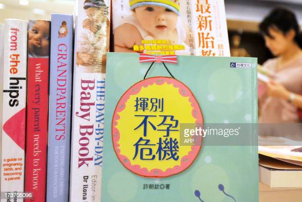 TaiwanhealthsurrogacyFEATURE by Amber Wang A variety of books on pregnancy and infertility are on display in a bookstore in Taipei on June 6 2013...