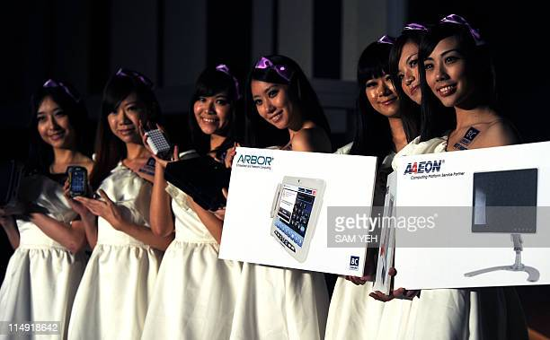 """Taiwan-IT-electronics"""" by Benjamin Yeh Model show off products during a press conference held in Taipei on May 24, 2011 ahead of Computex, Asia's..."""