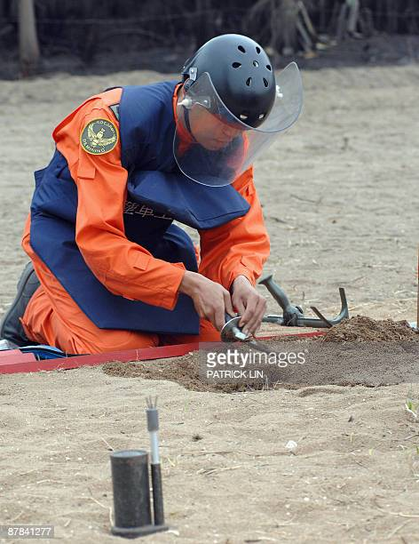 TaiwanpoliticsChinaMaanniversary by Benjamin Yeh A Taiwan army soldier wearing protective gear displays ways of clearing a landmine near the seashore...