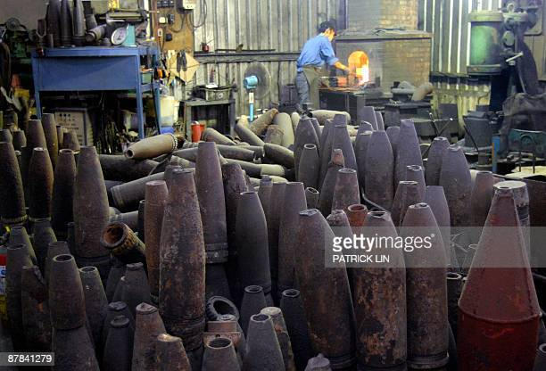 TaiwanpoliticsChinaMaanniversary by Benjamin Yeh The picture taken on May 18 2009 shows artillery shells piled up at a knife shop on Taiwancontrolled...