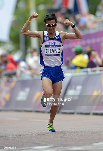 Taiwan's Chang ChiaChe celebrates as he crosses the finish line of the athletics event men's marathon during the London 2012 Olympic Games on August...