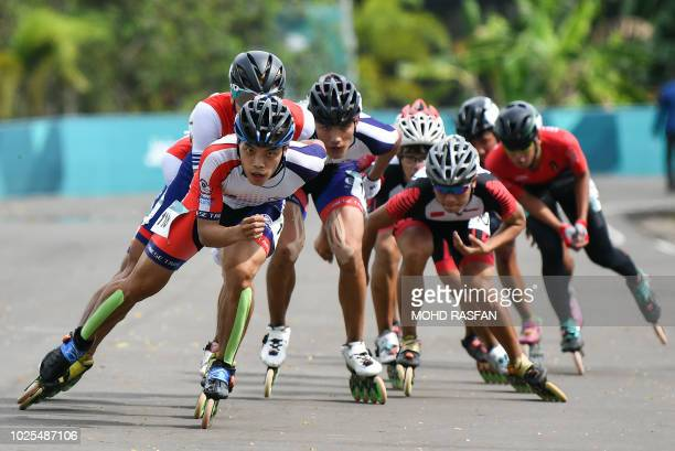 TOPSHOT Taiwan's Chao Tsucheng leads the pack in the men's roller skate road 20km race final during the 2018 Asian Games in Palembang on August 31...