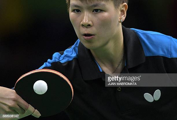 Taiwan's Chen SzuYu hits a shot in the women's team qualification round table tennis match against Hong Kong at the Riocentro venue during the Rio...